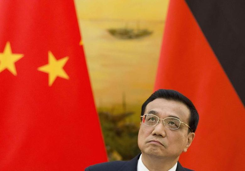 Chinese Premier Li Keqiang looks on during a joint news conference with German Chancellor Angela Merkel (not pictured) at the Great Hall of the People in Beijing July 7, 2014. REUTERS/Andy Wong/Pool