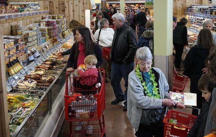 Shoppers look over the offerings at the new Trader Joe's store in Boulder, Colorado February 14, 2014. REUTERS/Rick Wilking