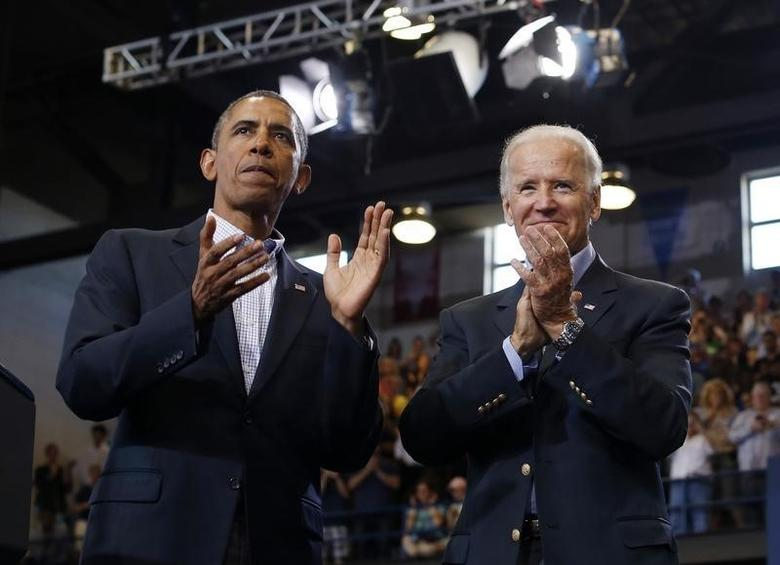 U.S. President Barack Obama (L) and Vice President Joe Biden appear at an event in Biden's home town of Scranton, Pennsylvania, August 23, 2013. REUTERS/Jason Reed