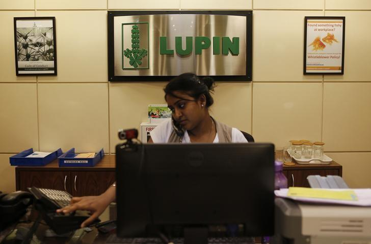 An employee of Lupin Limited works at a reception at their headquarters in Mumbai November 22, 2013.  REUTERS/Danish Siddiqui/Files