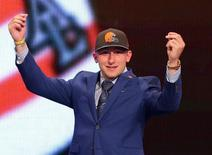 Johnny Manziel (Texas A&M) gestures on stage after being selected as the number twenty-two overall pick in the first round of the 2014 NFL Draft to the Cleveland Browns at Radio City Music Hall. May 8, 2014; New York, NY, USA;Brad Penner-USA TODAY Sports