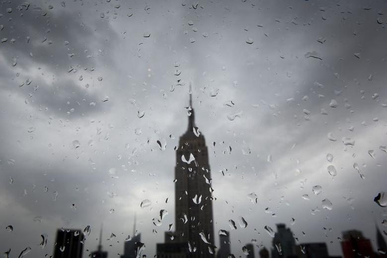 The Empire State Building is pictured through a rain-splattered window in the Manhattan borough of New York July 4, 2014.   REUTERS/Carlo Allegri