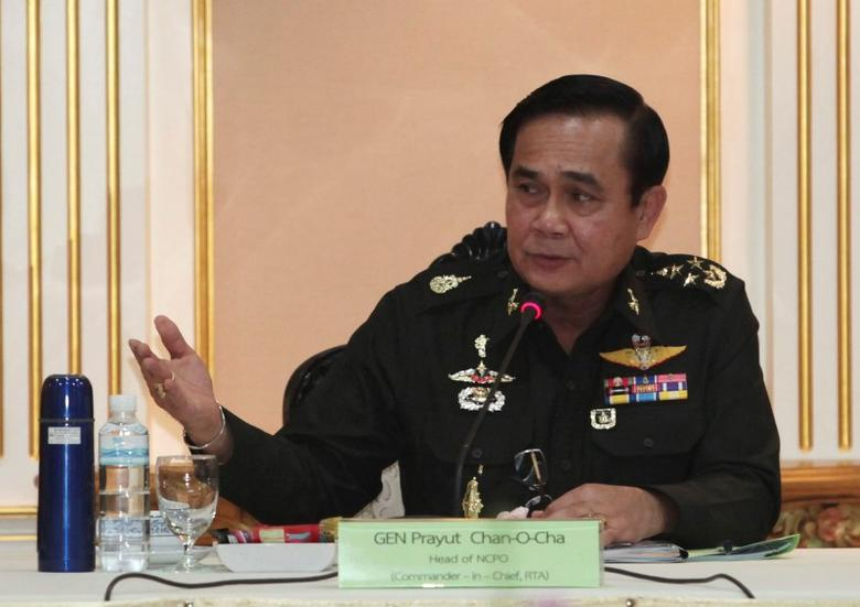 Thai Army chief General Prayuth Chan-ocha speaks during a meeting with members of the International Chamber of Commerce at the Royal Thai Army Headquarters in Bangkok June 19, 2014. REUTERS/Chanat Katanyu