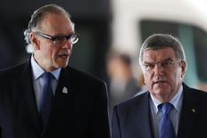 President of Brazil's Olympic Committee Carlos Arthur Nuzman (L) and International Olympic Committee (IOC) President Thomas Bach are seen arriving at the Planalto Palace before a meeting with Brazil's President Dilma Rousseff (not pictured) in Brasilia July 11, 2014. REUTERS/Ueslei Marcelino