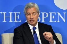 "JPMorgan Chase Chairman and CEO Jamie Dimon speaks during a discussion on ""Closing the Workforce Skills Gap"" at the Aspen Institute in Washington December 12, 2013. REUTERS/Mike Theiler"