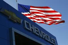 The Chevrolet logo and the U.S. flag are seen in Gaithersburg, Maryland May 1, 2013. REUTERS/Gary Cameron