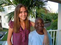Morgan Wienberg (L), 22, poses with 14-year-old Ysaac Jeudy of Haiti, an orphan who lost his mother in the 2010 earthquake, in Miami, Florida June 17, 2014.  REUTERS/David Adams