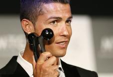 Cristiano Ronaldo posa para foto durante evento promocional em Tóquio, no dia 22 de julho.  REUTERS/Issei Kato