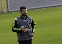 Spain's player Gerard Pique runs during a training session ahead of the 2014 World Cup in Curitiba, June 9, 2014.  REUTERS/Henry Romero