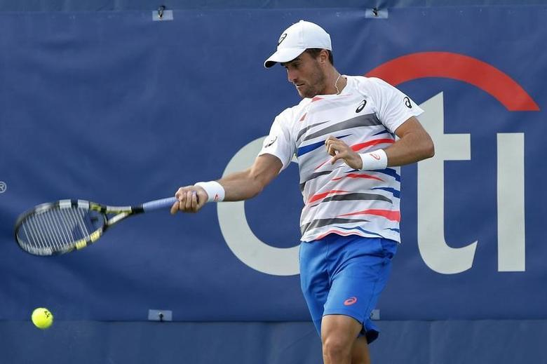 Jul 30, 2014; Washington, DC, USA; Steve Johnson hits a forehand against John Isner (not pictured) on day three of the Citi Open tennis tournament at Fitzgerald Tennis Center. Johnson won 6-7, 6-3, 7-6. Mandatory Credit: Geoff Burke-USA TODAY Sports - RTR40PWG