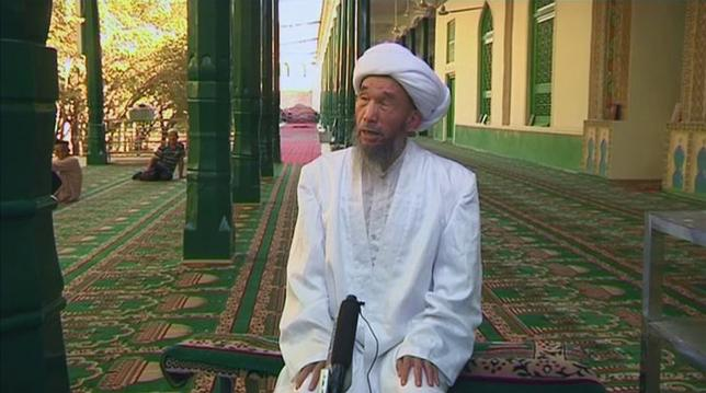 Juma Tayir speaks during an interview at Id Kah Mosque in Kashgar in this still image taken from video dated August 3, 2011.  REUTERS/ Reuters TV