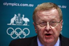 John Coates, President of the Australian Olympic Committee (AOC), announces the findings of a probe into the conduct of Australia's swimming team members in the run-up to the 2012 London Games, at a media conference in Sydney August 23, 2013. REUTERS/David Gray