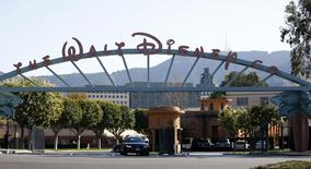 The entrance gate to The Walt Disney Co is pictured in Burbank, California in this file photo taken February 5, 2014.   REUTERS/Mario Anzuoni/Files
