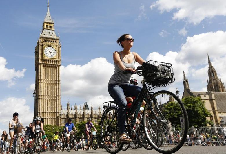 Cyclists of all ages ride past the Houses of Parliament during the Prudential RideLondon FreeCycle ride in central London in this file photograph dated August 3, 2013.  REUTERS/Luke MacGregor/files
