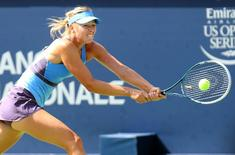Aug 6, 2014; Montreal, Quebec, Canada; Maria Sharapova (RUS) plays against Garbine Muguruza (ESP) on day three of the Rogers Cup tennis tournament at Uniprix Stadium.  Jean-Yves Ahern-USA TODAY Sports