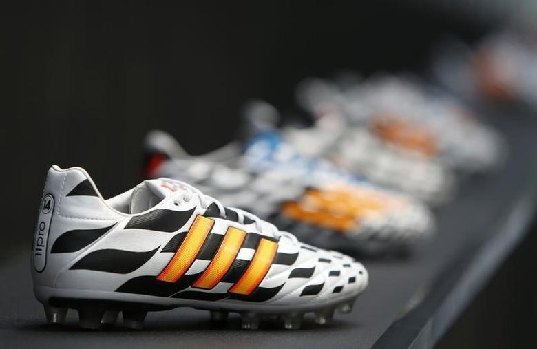 Adidas soccer shoes are pictured before the company's news conference in the northern Bavarian town of Herzogenaurach, near Nuremberg in this June 24, 2014 file photo.   REUTERS/Michaela Rehle/Files