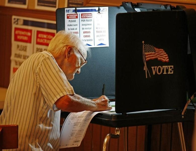 An unidentified voter casts his ballot at a local polling station in Miami November 2, 2010.   REUTERS/Hans Deryk
