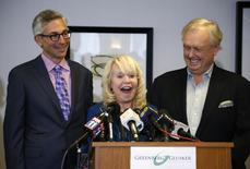 Shelly Sterling (C), her lawyer Pierce O'Donnell (R), and Steve Ballmer's lawyer Adam Streisand (2nd R) speak at a news conference to discuss the sale of the Los Angeles Clippers to Steve Ballmer in Los Angeles, California August 12, 2014. REUTERS/Lucy Nicholson