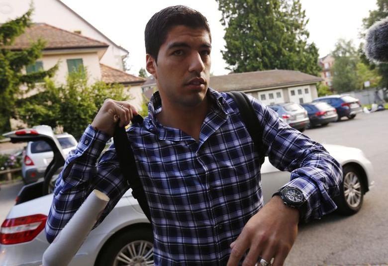 Uruguayan striker Luis Suarez arrives for a hearing at the Court of Arbitration for Sport (CAS) in Lausanne August 8, 2014. REUTERS/Denis Balibouse