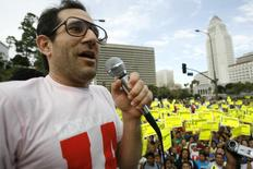 American Apparel owner Dov Charney speaks during a May Day rally protest march for immigrant rights, in downtown Los Angeles in this May 1, 2009 file photo. A series of boardroom battles across North America underscore how difficult it can be for companies to part ways with their founders. In each of these cases, the boards decided it was time for the founders to step down from their roles either as chief executive or chairman, but faced stiff resistance from the founders, some of whom used their substantial equity stakes to fight back. Corporate governance experts expect more such corporate dramas as shareholders are increasingly holding boards accountable for succession planning, investment returns and overall fiduciary duties. As a result, boards are asserting their authority more frequently, which can put them on collision courses with CEOs, including founders. To match Feature CORPORATE-GOVERNANCE-FOUNDERS/   REUTERS/Mario Anzuoni/Files   (UNITED STATES - Tags: POLITICS BUSINESS EMPLOYMENT CIVIL UNREST SOCIETY IMMIGRATION)