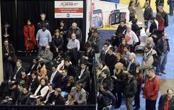 A speaker addresses a crowd at the 2014 Spring National Job Fair and Training Expo in Toronto, April 3, 2014. REUTERS/Aaron Harris