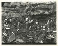 Workers load holes with dynamite to blast part of the Culebra Cut along the Panama Canal in this February 1912 archival handout photo obtained by Reuters August 14, 2014. REUTERS/Panama Canal Museum Collection/George A. Smathers Libraries/University of Florida/Handout via Reuters