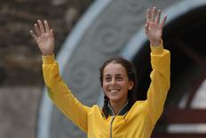 Australia's Brittany Dutton celebrates after winning the women's triathlon during the 2014 Nanjing Youth Olympic Games in Nanjing, Jiangsu province, August 17, 2014. REUTERS/Aly Song