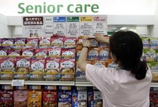 A staff arranges Kewpie Corp's nursing care food packages on a display shelf at an Ito-Yokado shopping centre in Tokyo August 5, 2014. REUTERS/Yuya Shino