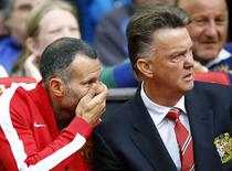 Manchester United's manager Louis van Gaal (R) and his assistant Ryan Giggs watch their team during their English Premier League soccer match against Swansea City at Old Trafford in Manchester, northern England August 16, 2014. REUTERS/Darren Staples