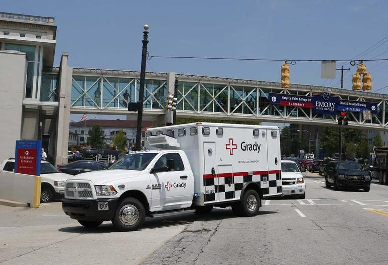 An ambulance carrying American missionary Nancy Writebol, 59, who is infected with Ebola in West Africa, arrives at Emory University Hospital in Atlanta, Georgia August 5, 2014.  REUTERS/Tami Chappell