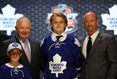 Jun 27, 2014; Philadelphia, PA, USA; William Nylander poses for a photo with team officials after being selected as the number eight overall pick to the Toronto Maple Leafs in the first round of the 2014 NHL Draft at Wells Fargo Center. Mandatory Credit: Bill Streicher-USA TODAY Sports