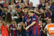Messi e Neymar comemoram gol em amistoso do Barcelona no Camp Nou. 18/08/2014  REUTERS/Gustau Nacarino
