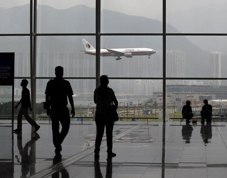 A Malaysia Airlines Boeing 777 plane is seen from the departure hall at the Hong Kong International Airport June 2, 2011. REUTERS/Bobby Yip