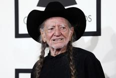Musician Willie Nelson arrives at the 56th annual Grammy Awards in Los Angeles, California January 26, 2014.  REUTERS/Danny Moloshok