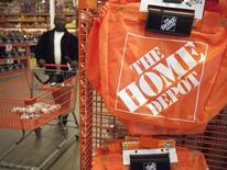 A customer wheels a cart through a Home Depot store in Washington February 20, 2012.  REUTERS/Jonathan Ernst