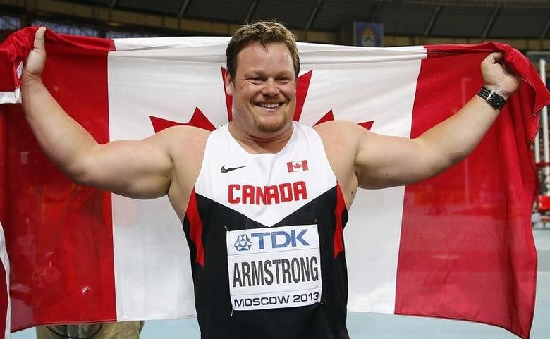 Dylan Armstrong of Canada celebrates winning bronze medal in the men's shot put final during the IAAF World Athletics Championships at the Luzhniki stadium in Moscow August 16, 2013.        REUTERS/Kai Pfaffenbach