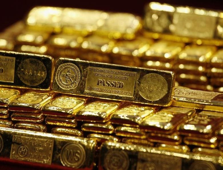 New five-tael 24K gold bars, issued by the Chinese Gold and Silver Exchange Society, Hong Kong's major gold and silver exchange, are introduced during the first trading day after the Chinese New Year holidays in Hong Kong February 14, 2013.  REUTERS/Bobby Yip/Files