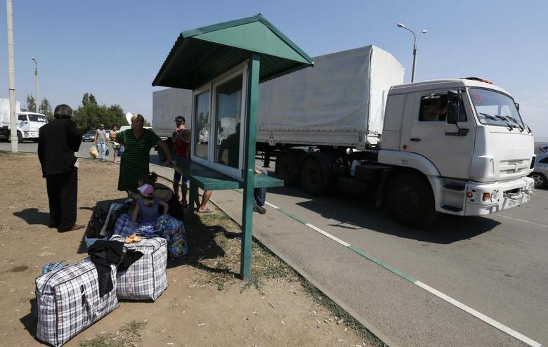 U.S. says Russia must pull convoy from Ukraine or face...
