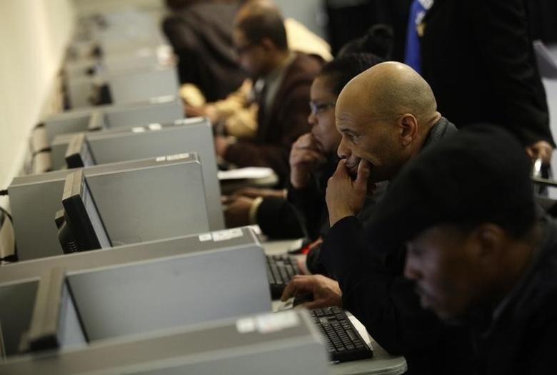 People use computers at a job fair in Detroit, Michigan March 1, 2014. REUTERS/Joshua Lott