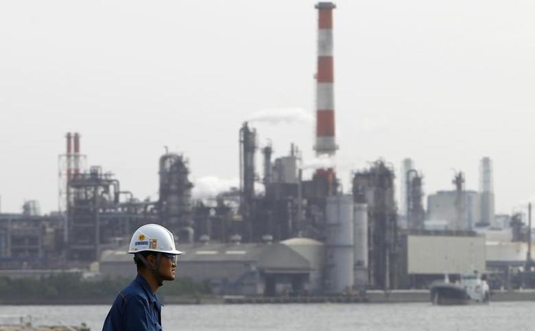 A worker is seen near a factory in Keihin industrial zone in Kawasaki, south of Tokyo May 31, 2011. REUTERS/Toru Hanai