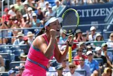 Aug 27, 2014; New York, NY, USA; Shuai Peng (CHN) reacts to defeating Agnieszka Radwanska (POL) on Armstrong Stadium on day three of the 2014 U.S. Open tennis tournament at USTA Billie Jean King National Tennis Center. Mandatory Credit: Anthony Gruppuso-USA TODAY Sports