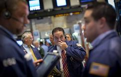 Traders work on the floor of the New York Stock Exchange August 26, 2014. REUTERS/Brendan McDermid