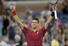 Novak Djokovic (SRB) celebrates recording match point in his match against Diego Schwartzman (ARG) on day one of the 2014 U.S. Open tennis tournament at USTA Billie Jean King National Tennis Center. Aug 25, 2014; New York, NY, USA; Susan Mullane-USA TODAY Sports