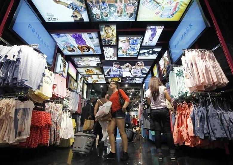 Customers shop at a Primark store on Oxford Street in London June 20, 2014.  REUTERS/Luke MacGregor