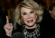 Comedian Joan Rivers talks to reporters as she arrives for a gala honoring the late stand-up comedian George Carlin, the 11th Annual Mark Twain Prize for American Humor recipient, at the Kennedy Center in Washington in this file photo taken November 10, 2008.  REUTERS/Molly Riley/Files