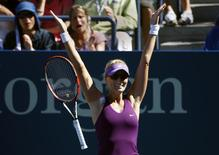 Mirjana Lucic-Baroni of Croatia raects after defeating Simona Halep of Romania during their match at the 2014 U.S. Open tennis tournament in New York, August 29, 2014. REUTERS/Adam Hunger