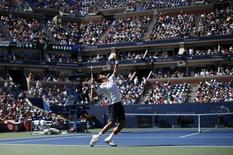 Novak Djokovic of Serbia serves to Paul-Henri Mathieu of France during their match at the 2014 U.S. Open tennis tournament in New York, August 28, 2014. REUTERS/Mike Segar