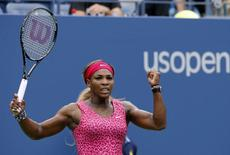 Serena Williams of the U.S. celebrates a point against Kaia Kanepi of Estonia during their match at the 2014 U.S. Open tennis tournament in New York, September 1, 2014.    REUTERS/Ray Stubblebine