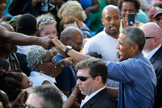 U.S. President Barack Obama greets people in the crowd after delivering remarks at Laborfest 2014 at Maier Festival Park in Milwaukee, Wisconsin September 1, 2014.  REUTERS-Jonathan Ernst