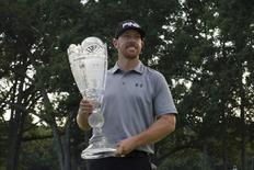 Aug 24, 2014; Paramus, NJ, USA; Hunter Mahan holds the Barclays Trophy winning the The Barclays golf tournament with a score of 14 under par at Ridgewood Country Club. Mandatory Credit: Tommy Gilligan-USA TODAY Sports